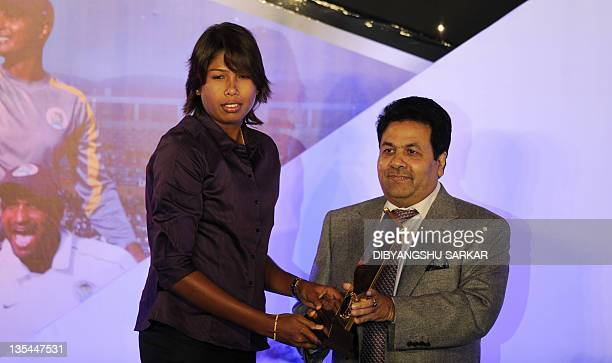 An official from the Board of Control for Cricket in India Rajiv Shukla presents the best women cricketer of the year award to Jhulan Goswamy during...