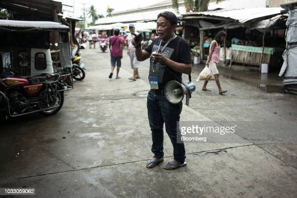 An official from the Mayor's office uses a megaphone to make announcements ahead of Typhoon Mangkhut's arrival in Tuguegarao Cagayan province the...
