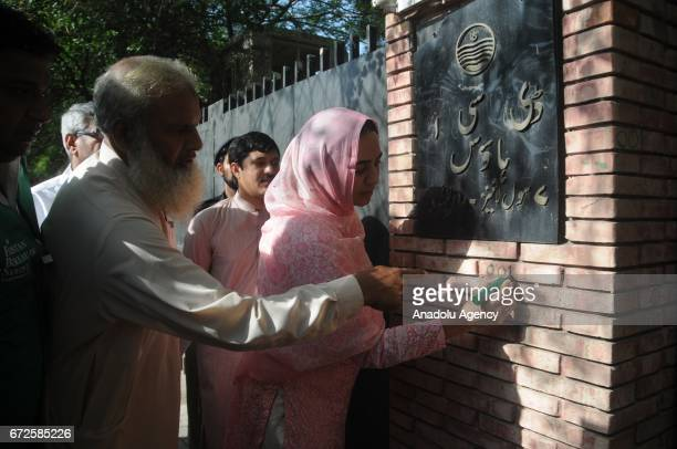 An official from the Pakistan Bureau of Statistics marks a house before collecting information from a resident during the second phase of sixth...