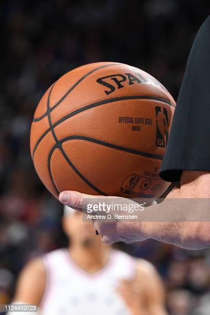 An official game ball is held by a referee during the game between the Los Angeles Lakers and Philadelphia 76ers on February 10 2019 at the Wells...