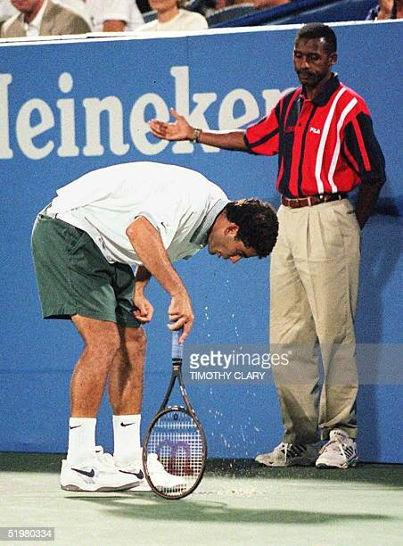 An official halts play as Pete Sampras of the US gets sick on the court 05 Sept at the US Open during his match against Alex Corretja of Spain in...