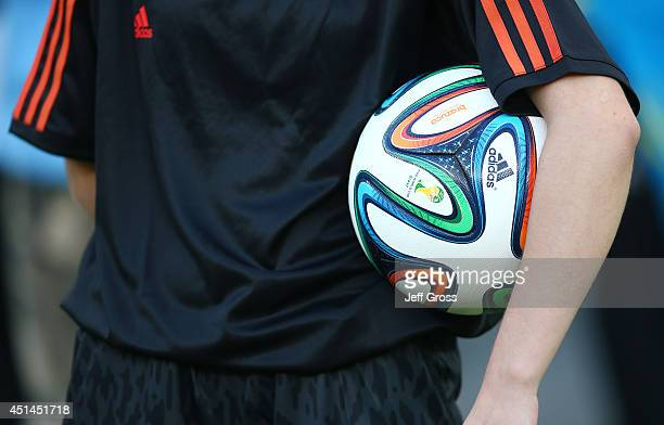 An official holds a 'Brazuca' match ball during the 2014 FIFA World Cup Brazil Round of 16 match between Costa Rica and Greece at Arena Pernambuco on...