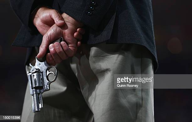 An official holds a starting pistol on Day 12 of the London 2012 Olympic Games at Olympic Stadium on August 8 2012 in London England