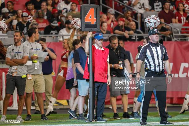 An official holds the dial a down marker during the NFL preseason football game between the Oakland Raiders and the Arizona Cardinals on August 15,...