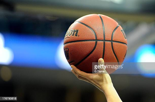 An official holds up a basketball in the game between the Connecticut Huskies and the Maryland Terrapins during the East Region Sweet 16 of the NCAA...