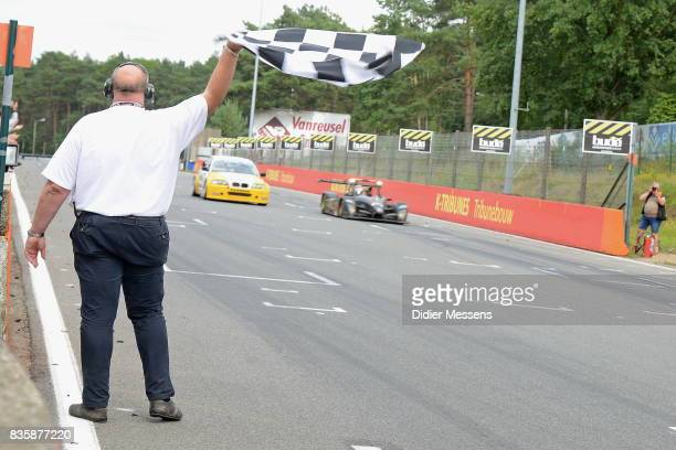 An official is waving the finish flag to end the Zolder 24 hours on August 20 2017 in HeusdenZolder Belgium