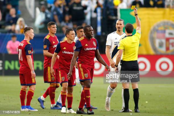 An official issues a yellow card to Zlatan Ibrahimovic of Los Angeles Galaxy after a foul on Nedum Onuoha of Real Salt Lake during the second half of...