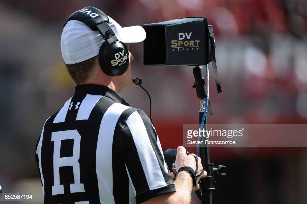 An official looks at a replay screen during the game between the Nebraska Cornhuskers and the Rutgers Scarlet Knights at Memorial Stadium on...