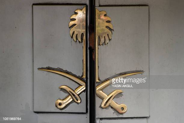 An official looks from inside the Saudi Arabia's consulate in Istanbul on October 12 2018 A Saudi delegation has arrived in Turkey for talks on...