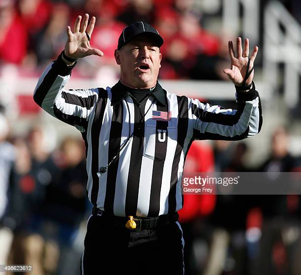 An official makes a call during a game against the UCLA Bruins and the Utah Utes during the first half of a college football game at Rice Eccles...