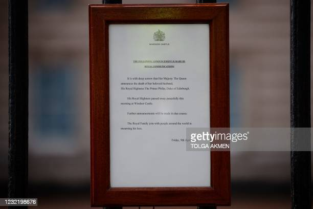 An official notice announcing the death of Britain's Prince Philip, Duke of Edinburgh is seen on the gates of Buckingham Palace in central London on...