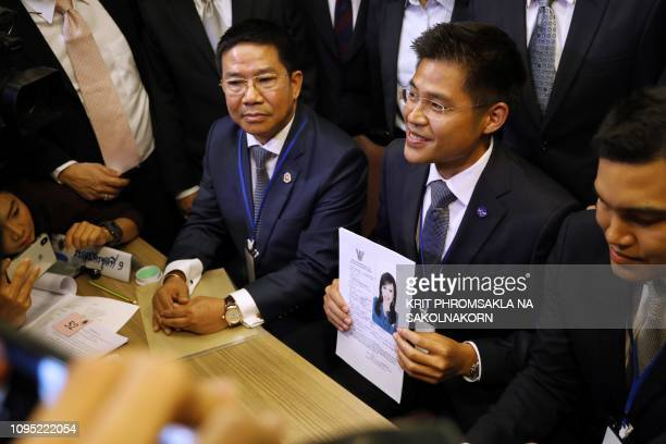 TOPSHOT An official of Raksa Chart party holds the registration document bearing the photograph of Thai Princess Ubolratana prior to submitting to...