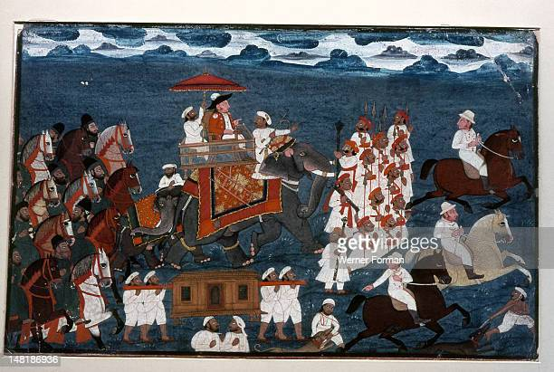 An official of the British East India Company riding on an elephant with an escort of foot soldiers and mounted Indian retainers India Indian End of...