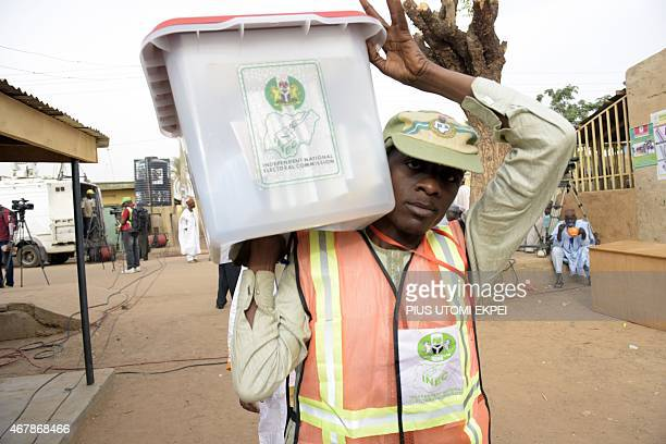 An official of the Independent National Electoral Commission arrives with electoral documents on March 28 2015 at a polling station in Gidan Niyam...