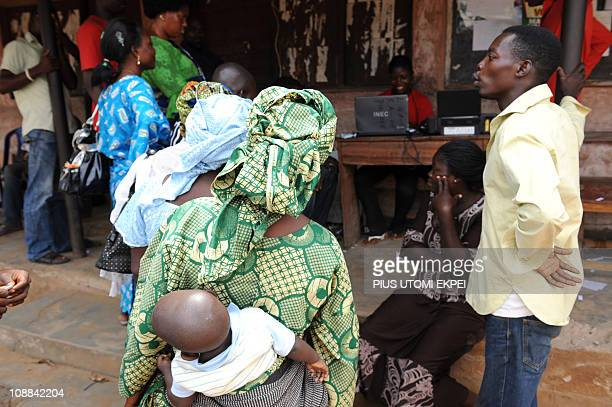 An official of the Independent National Electoral Commission registers prospective voters during a registration exercise in the Mushin distric in...
