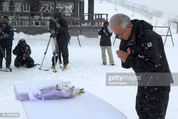 An official of the Kusatsu Kokusai Ski Resort in Gunma Prefecture Japan prays for Takayuki Izawa on Jan 30 a week after the 49yearold Ground...