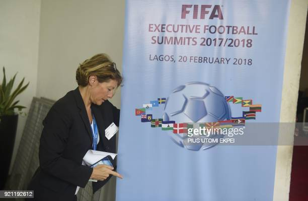 An official of the world football governing body FIFA tries to display banner for the FIFA executive football summit in Lagos on February 20 2018...