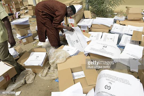 An official sorts documents at the secretariat of Independent National Electoral Commission in Kano on March 27 2015 President Goodluck Jonathan on...
