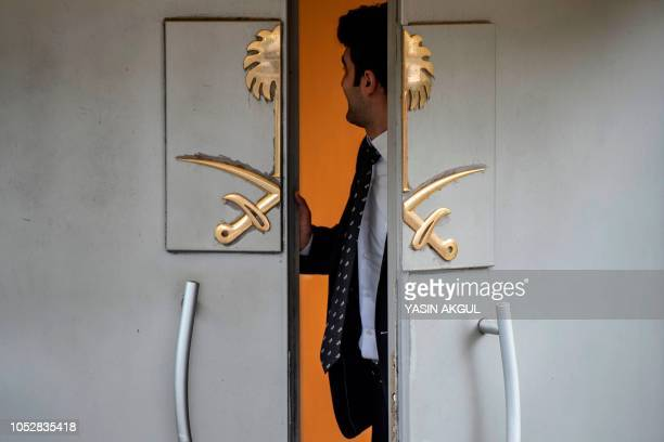 TOPSHOT An official stands at the door of Saudi Arabia's consulate in Istanbul on October 23 during ongoing investigations into the killing of Saudi...