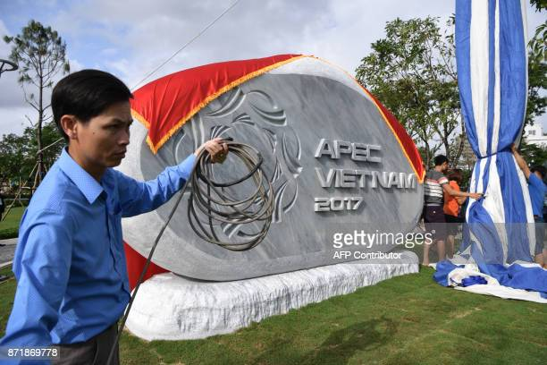 An official statue is unveiled at the inauguration of an APEC park and treeplanting ceremony by ministers on the sidelines of the AsiaPacific...