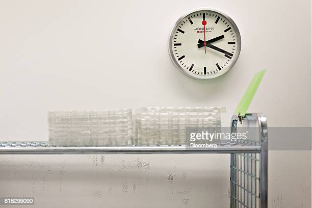 An official Swiss Railways wall clock sits on the wall at the Mondaine Watch Ltd production facility in Solothurn Switzerland on Tuesday Oct 25 2016...