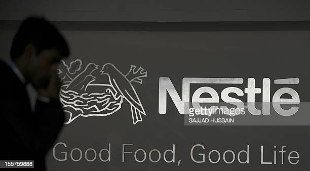 An official talks on his cell phone inside Nestle's first research and development centre in India at Manesar some 56 kms from New Delhi on November...