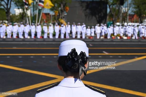 An official waits in a line for the arrival of Thailand's King Maha Vajiralongkorn in front of the Grand Palace ahead of his coronation in Bangkok on...