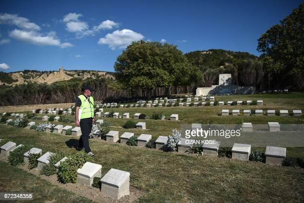 An official walks among graves at the ANZAC cemetery near the ANZAC cove on April 24 2017 in Canakkale before the ceremony celebrating the 102th...