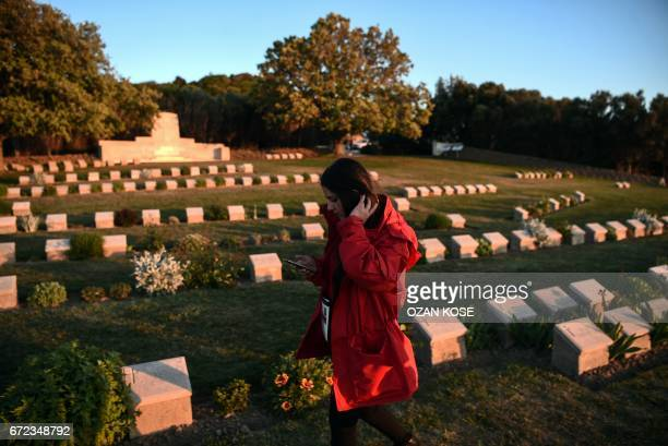 An official walks next to graves at the ANZAC cemetery near the ANZAC cove on April 24, 2017 in Canakkale before the ceremony celebrating the 102th...