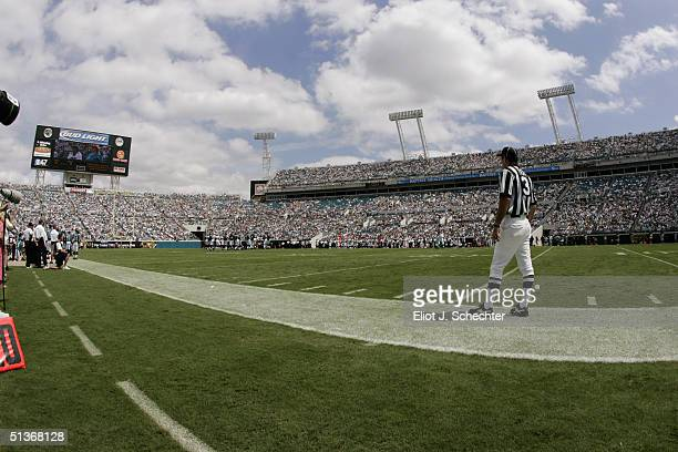 An official watches the game between the Jacksonville Jaguars and the Denver Broncos at ALLTEL Stadium on September 19 2004 in Jacksonville Florida...