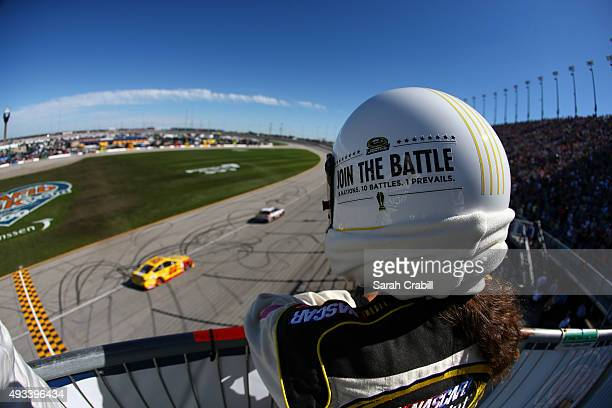 An official watches the track during the NASCAR Sprint Cup Series myAFibRiskcom 400 at Chicagoland Speedway on September 20 2015 in Joliet Illinois