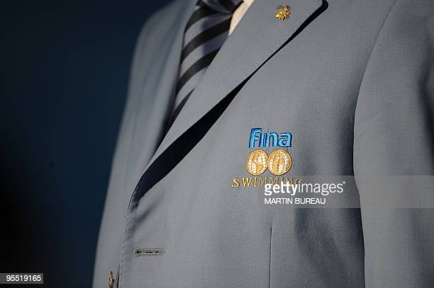 An official wears a jacket bearing the logo of the Swimming governing body FINA on July 27, 2009 at the FINA World Swimming Championships in Rome....