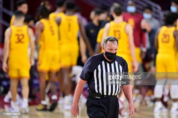 An official wears a mask while the USC Trojans play the Washington Huskies at Galen Center on January 14, 2021 in Los Angeles, California.
