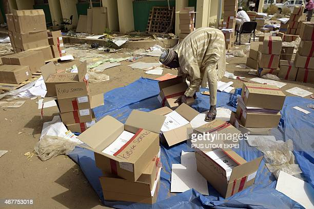 An officials sorts documents at the secretariat of Independent National Electoral Commission in Kano on March 27 2015 President Goodluck Jonathan on...