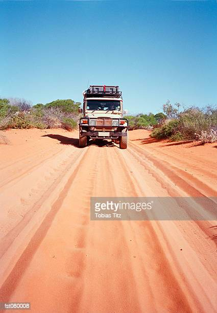 An off-road vehicle on a desert road in Australia