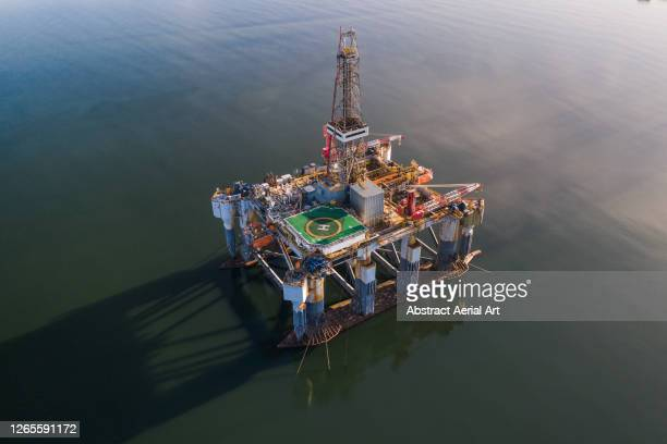 an offshore drilling platform seen from above, cromarty firth, scotland, united kingdom - business finance and industry stock pictures, royalty-free photos & images