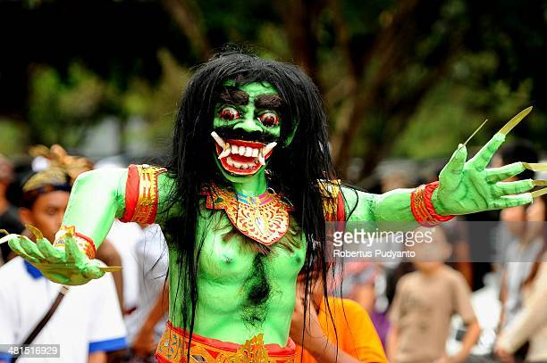 An Ogohogoh effigy is prepared for a parade on March 30 2014 in Surabaya Indonesia Balinese Hindus hold a Ogohogoh parade annually on the day before...
