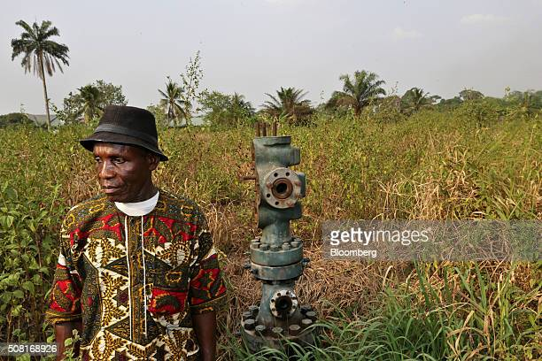 An Ogoni chief stands alongside the abandoned oil wellhead known as number 1 and previously operated by Royal Dutch Shell Plc in marshland near the...