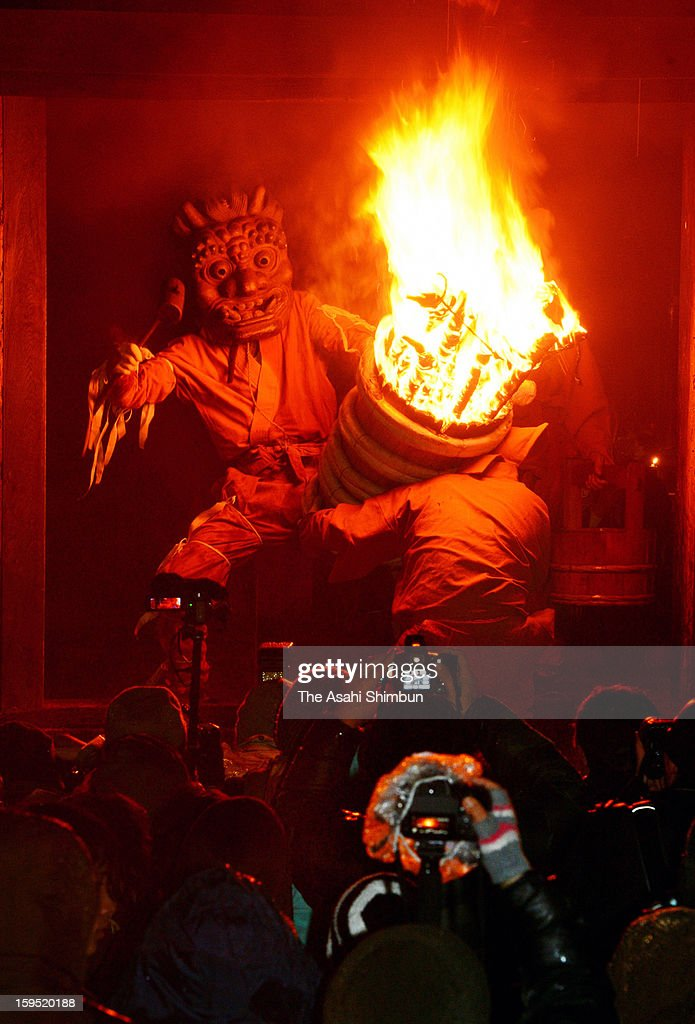 An ogre holding an flaming torch runs the corridor of Dadado, or Dada hall during the Dadado-no-Oni-Hashiri ritual at Nenbutsuji Temple on January 14, 2013 in Gojo, Nara, Japan. The annual event held on January 14 every year, has more than 500 years history, is known as a rare ritual the orges are not symbols of evil, but as the ones to give fortunes and hapiness.