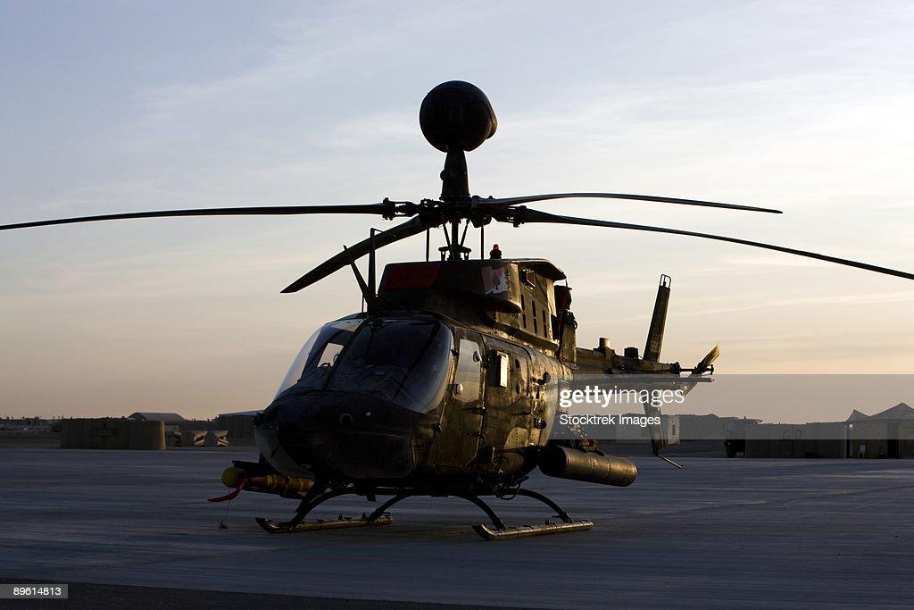 An OH-58D Kiowa during sunset. : Stock Photo