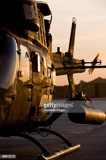 an oh-58d kiowa during sunset. - tikrit stock pictures, royalty-free photos & images