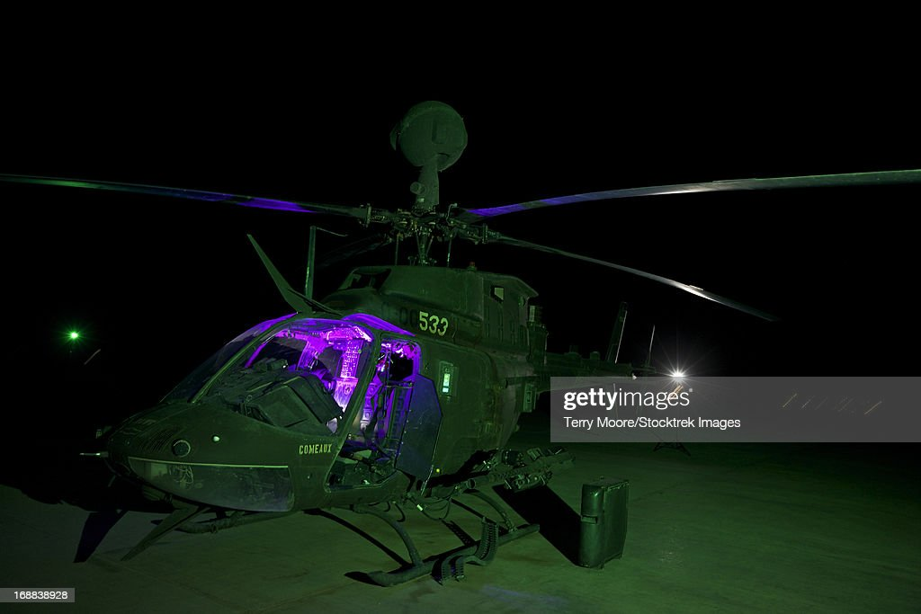 An OH-58D Kiowa helicopter at COB Speicher, Tikrit, Iraq, during Operation Iraqi Freedom. : Stock Photo