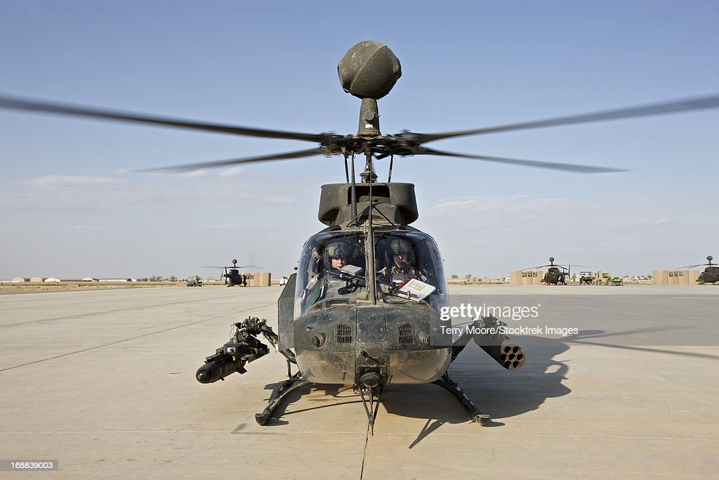 An OH-58D Kiowa helicopter prepares for liftoff from COB Speicher, Tikrit, Iraq, during Operation Iraqi Freedom. : Stock Photo