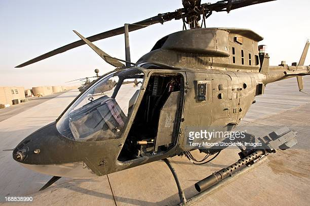 An OH-58D Kiowa helicopter sits on the tarmac at COB Speicher, Tikrit, Iraq, during Operation Iraqi Freedom