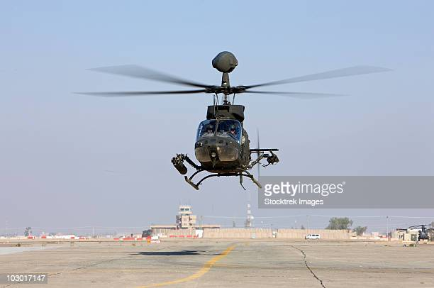 An OH-58D Kiowa Warrior hovers over the flight line at Camp Speicher, Iraq.