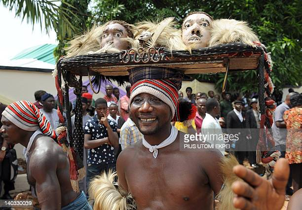 An Ohafia cultural troupê entertains bystanders during the burial of Nigeria's secessionist leader Odumegwu Ojukwu at his native Nnewi country home...