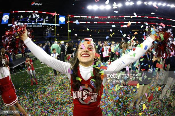 An Ohio State cheerleader celebrates following the 82nd Goodyear Cotton Bowl Classic between USC and Ohio State at ATT Stadium on December 29 2017 in...