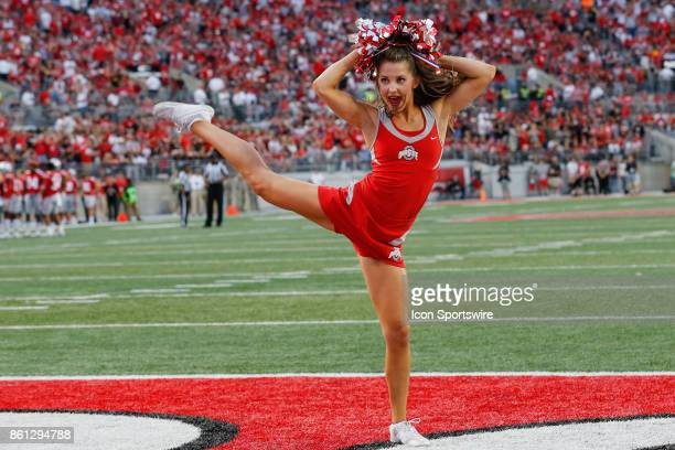 An Ohio State cheerleader performs during game action between the Army Black Knights and the Ohio State Buckeyes on September 16 2017 at Ohio Stadium...