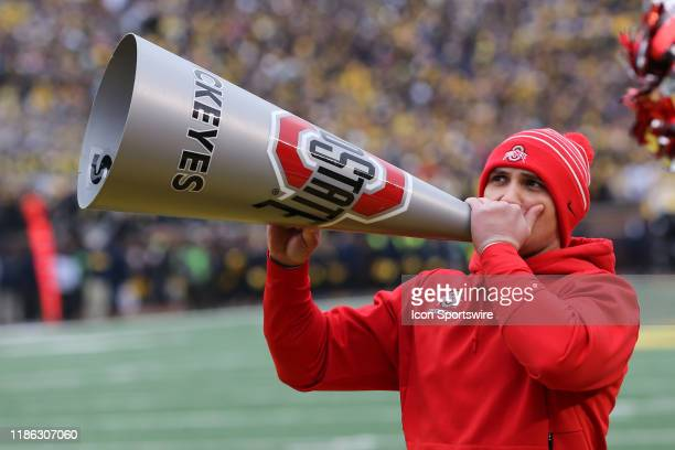 An Ohio State cheerleader shouts through a megaphone during a regular season Big 10 Conference game between the Ohio State Buckeyes and the Michigan...