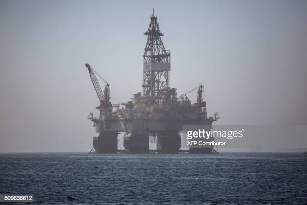 An Oil and Gas drilling rig operating in Angola is seen in the waters outside Walvis Bay for maintanance on June 24 2017 in Walvis Bay Namibia / AFP...